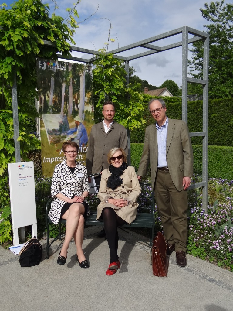 "L to R: Patricia Junker, André Dombrowski (standing), S. Hollis Clayson, and Philip Nord were among the scholars who gathered in May in Giverny, France, to participate in the international symposium ""L'Impressionnisme et la Politique."" Photo: Lucy Pike."