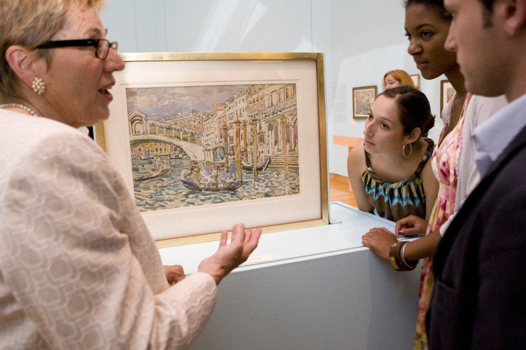 Visitors enjoy a painting by Maurice Prendergast in the 2009–2010 Terra Collection Initiative Prendergast in Italy.