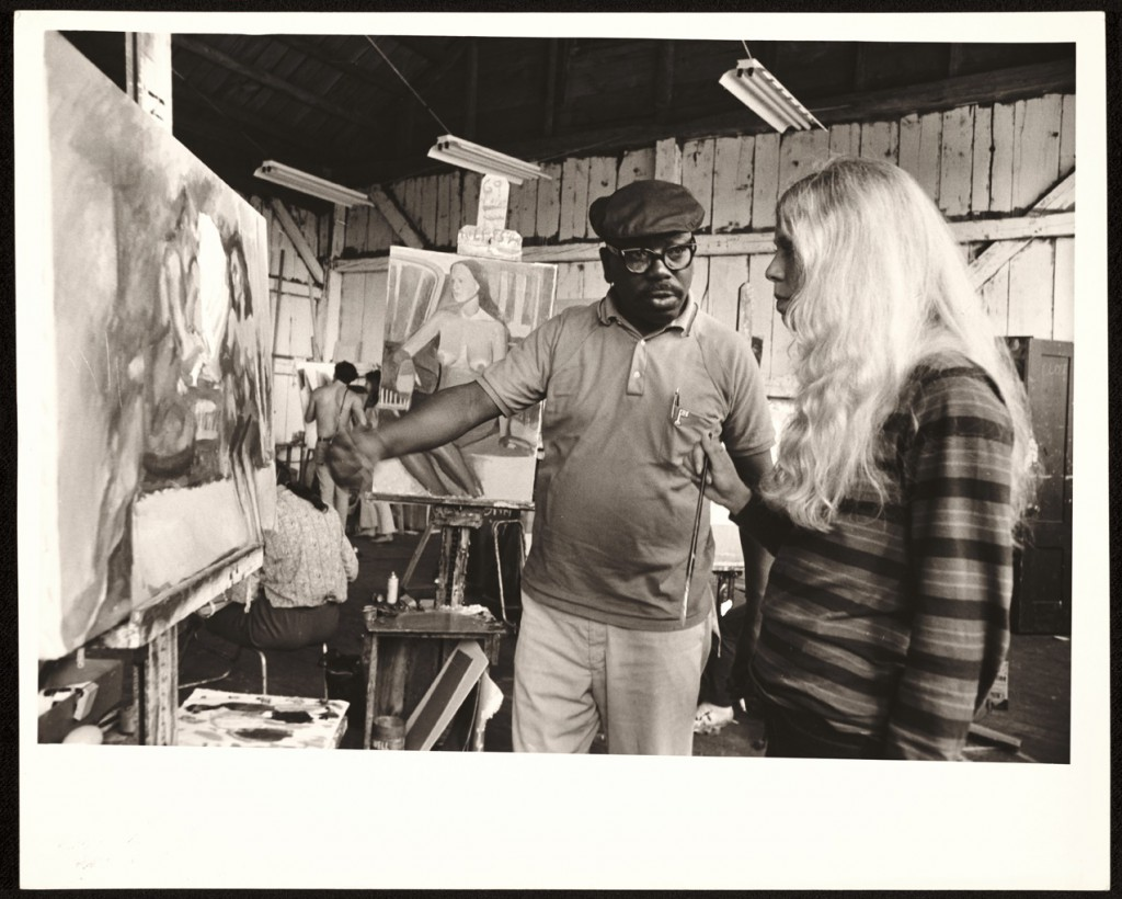 American artist Jacob Lawrence critiquing student work in 1968. Unidentified photographer. Skowhegan School of Painting and Sculpture records, Archives of American Art, Smithsonian Institution.
