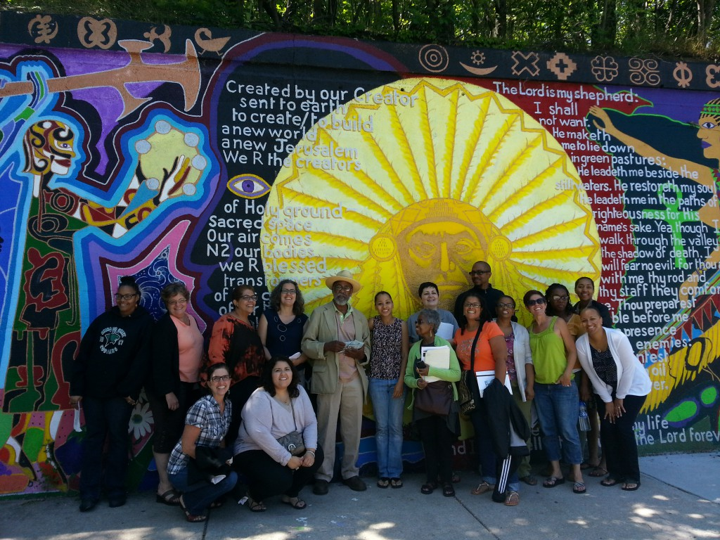 Artist Siddha Weber (center in hat) and teachers pose in front of a mural in the Bronzeville neighborhood as part of the Chicago Metro History Education Center's 2014 summer professional development program.