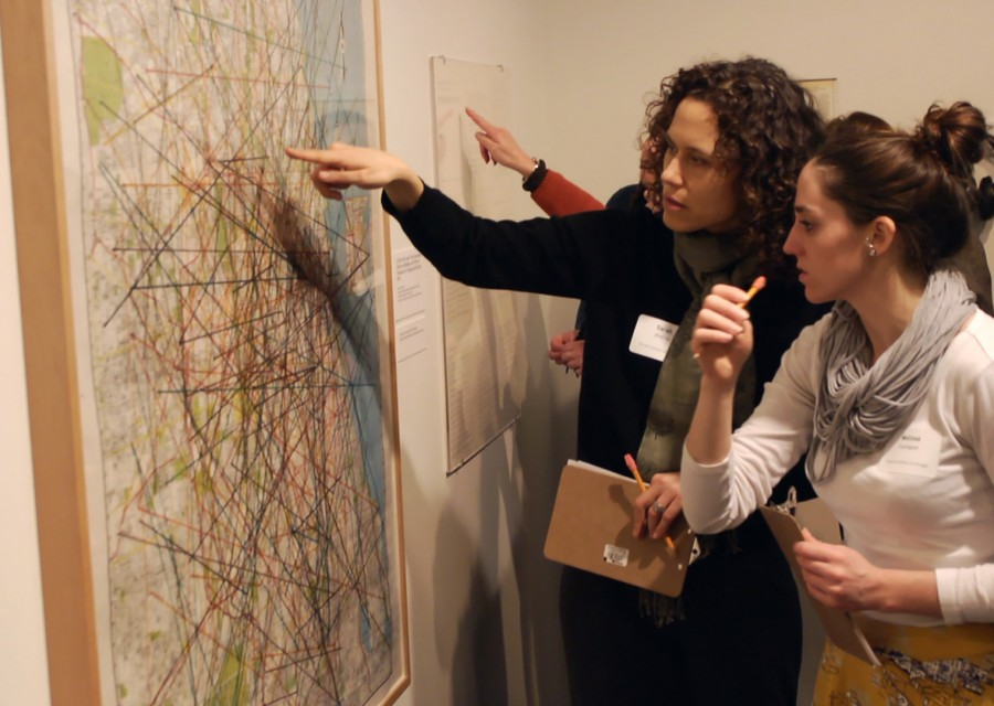 Museum educators Sarah Alvarez (left) and Melissa Covington, participants in the Terra Foundation's American Art at the Core of Learning initiative, discuss an artwork at the Museum of Contemporary Art, Chicago.