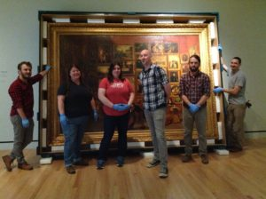 """Art handlers de-install the 2016 Terra Collective Initiative Samuel F. B. Morse's """"Gallery of the Louvre"""" and the Art of Invention at the Crystal Bridges Museum of American Art, Bentonville, AK."""