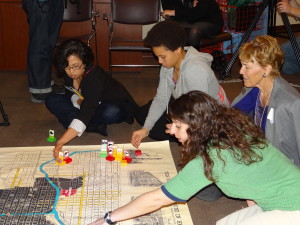 Learning Community Members participate in a demonstration of a map activity for younger children at the Chicago History Museum.