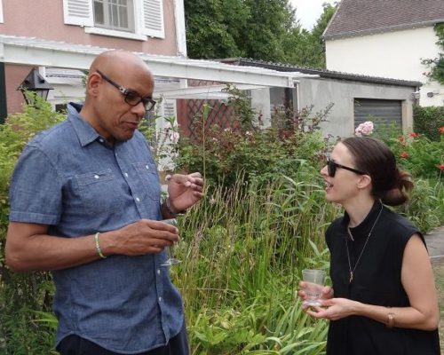 2015 Terra Summer Residency guest advisor Jeffrey C. Stewart (left) and Catherine Czacki in conversation outside the Mansuy house in Giverny, France.